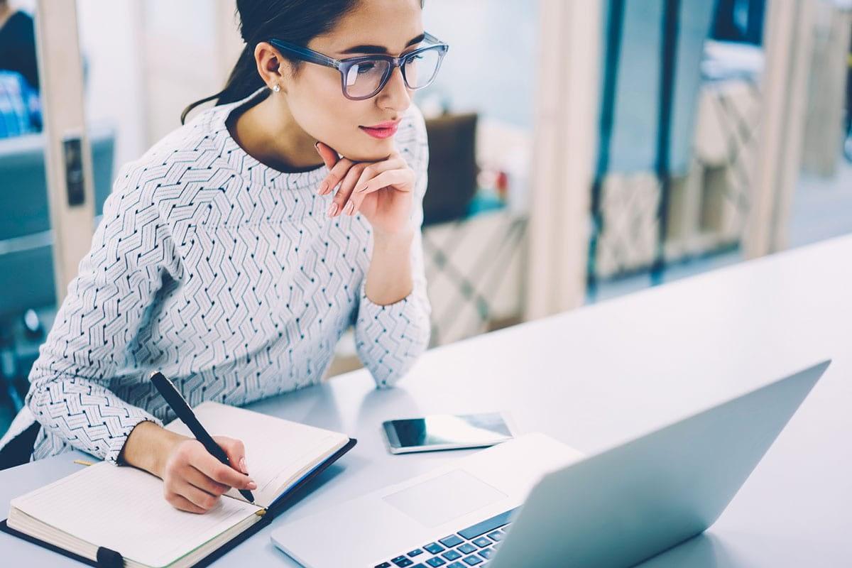 Woman focused on webinar